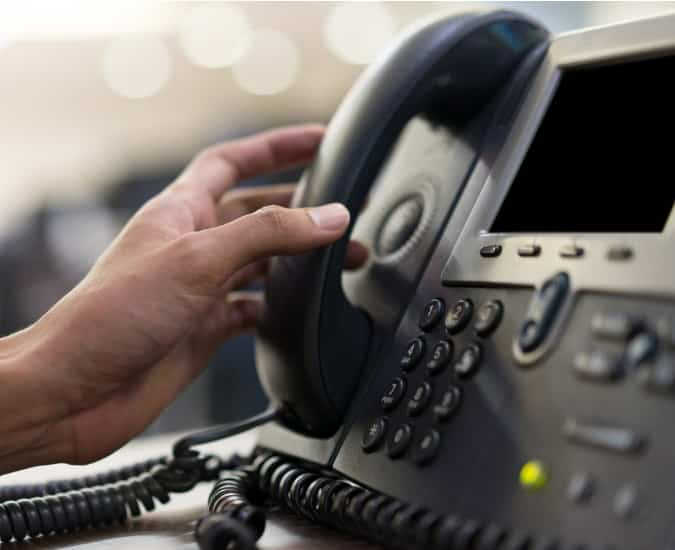 Business Owner Picking up the Phone to Call Support